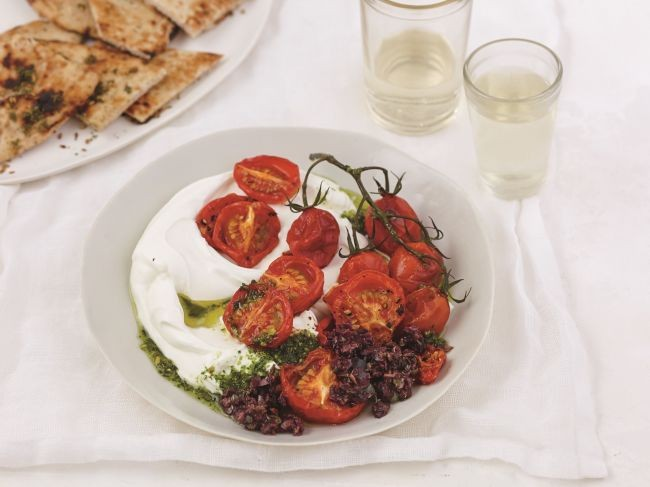 "A gorgeously simple appetizer from Cheryl Sternman Rule's ""Yogurt Culture"" featuring labneh (yogurt cheese), roasted tomatoes, tapenade, and pistachio pesto - a multi-cultural masterpiece of flavors."