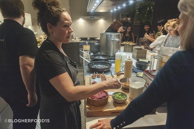 Stephanie Izard in her demo kitchen at Little Goat Chicago