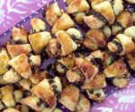 lots of chocolate rugelach on a purple plate