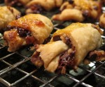 Rugelach out of the oven on a cooling rack waiting to be eaten