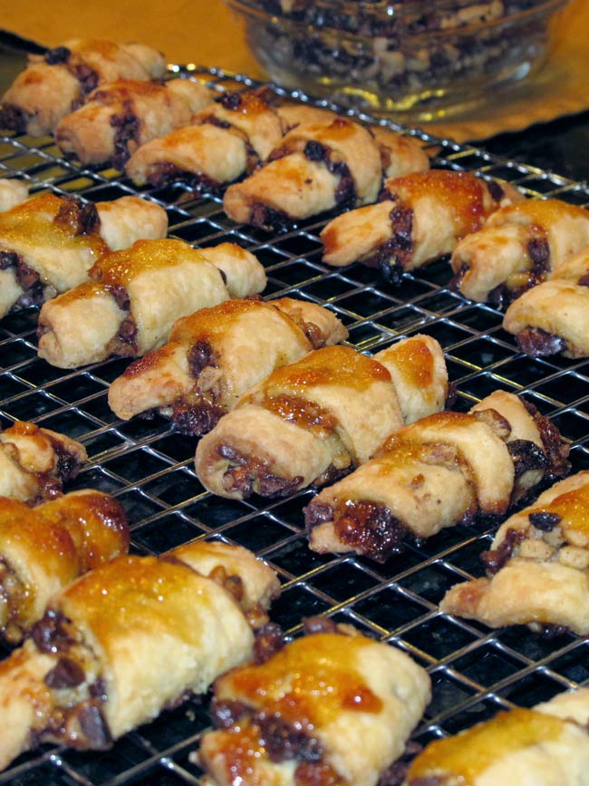 beauty shot of rugelach lined up on warming tray with filling in the background