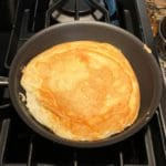 matzo meal pancake in frying pan cooked