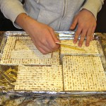 Placing matzoh in the pan