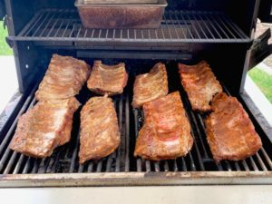 ribs spread out on bbq