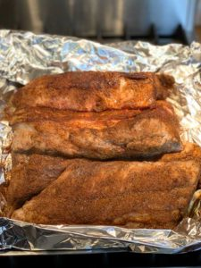 ribs rubbed with dry rub on foil