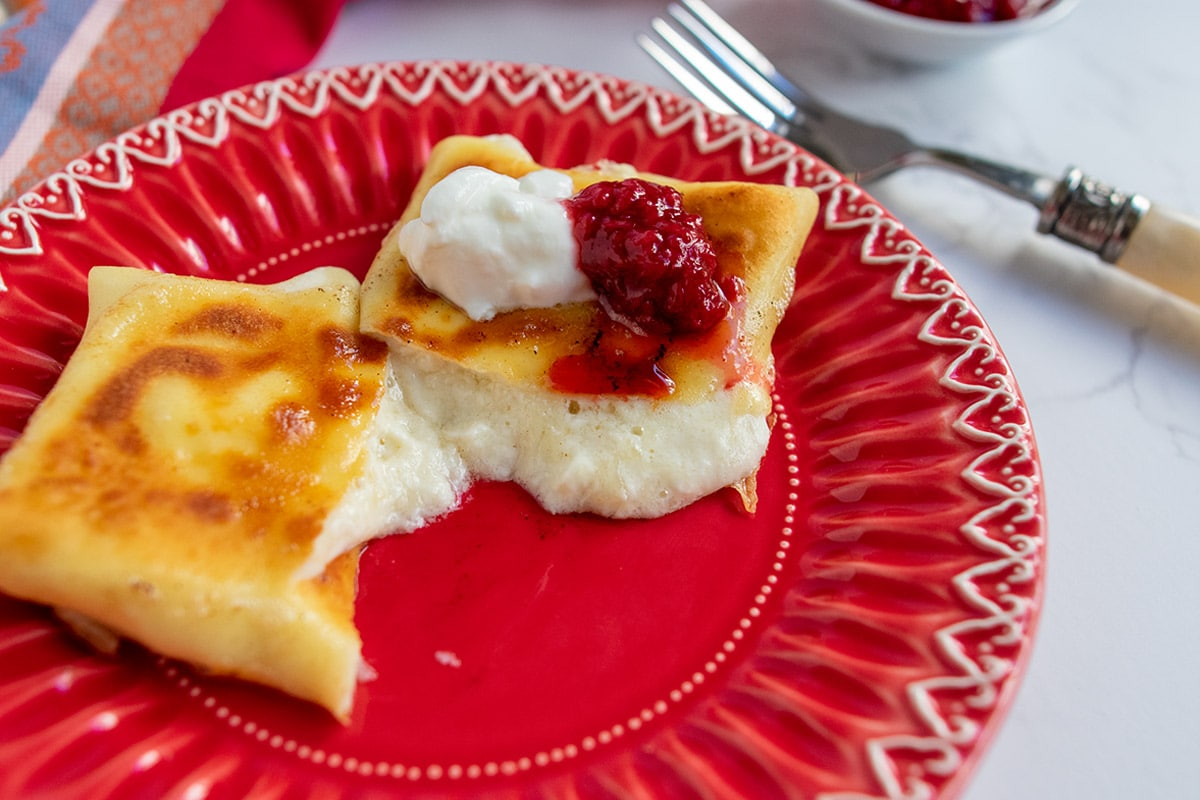 cheese blintz cut open and oozing melty cheese