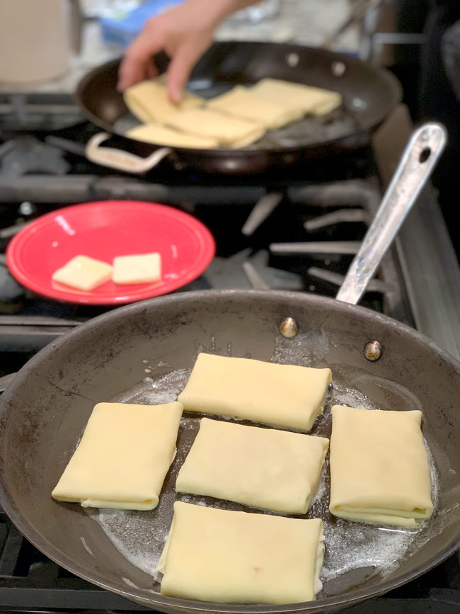 blintzes frying in pan