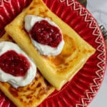 pinterestimage with 2 cheese blintzes on red plate