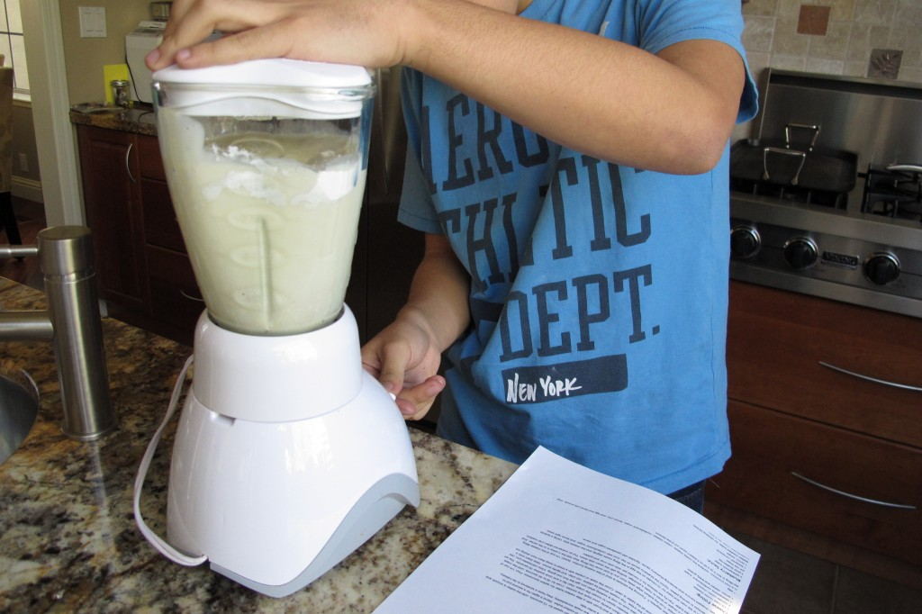 Gregory making crepe batter in blender