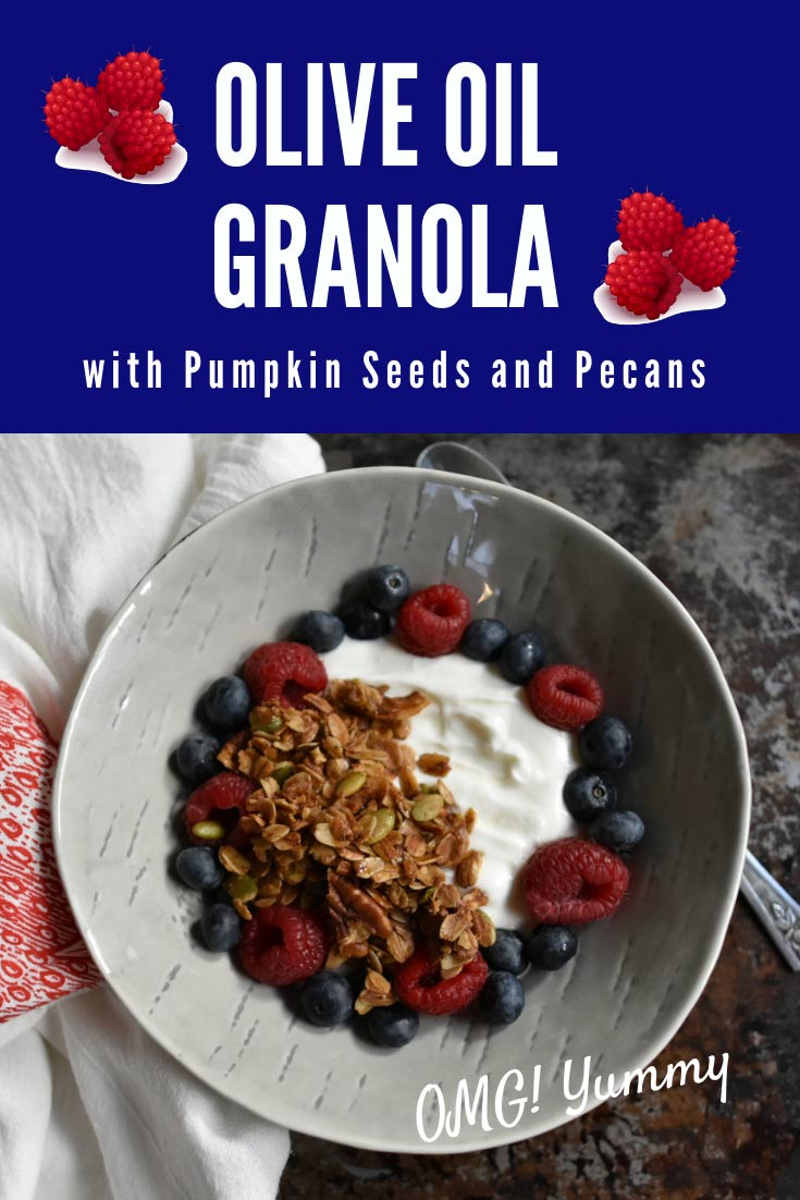 granola in a bowl with berries and yogurt