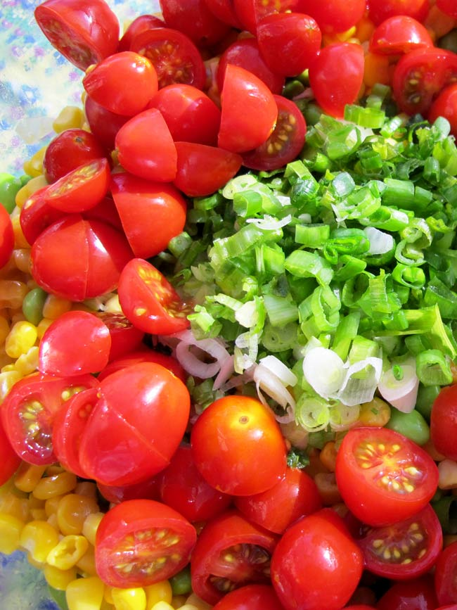 green onions and tomatoes in bowl unmixed corn salad