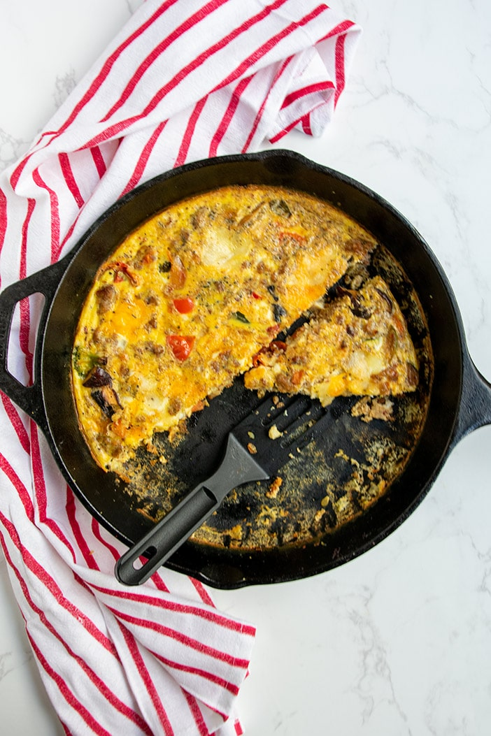 frittata slice on spatula cast iron pan