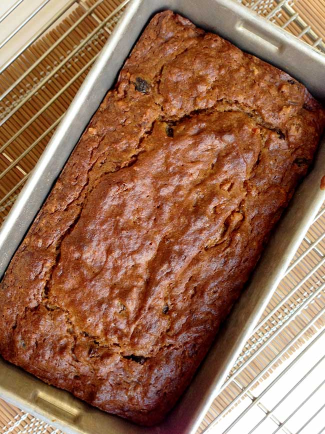 persimmon bread baked in loaf pan at an angle
