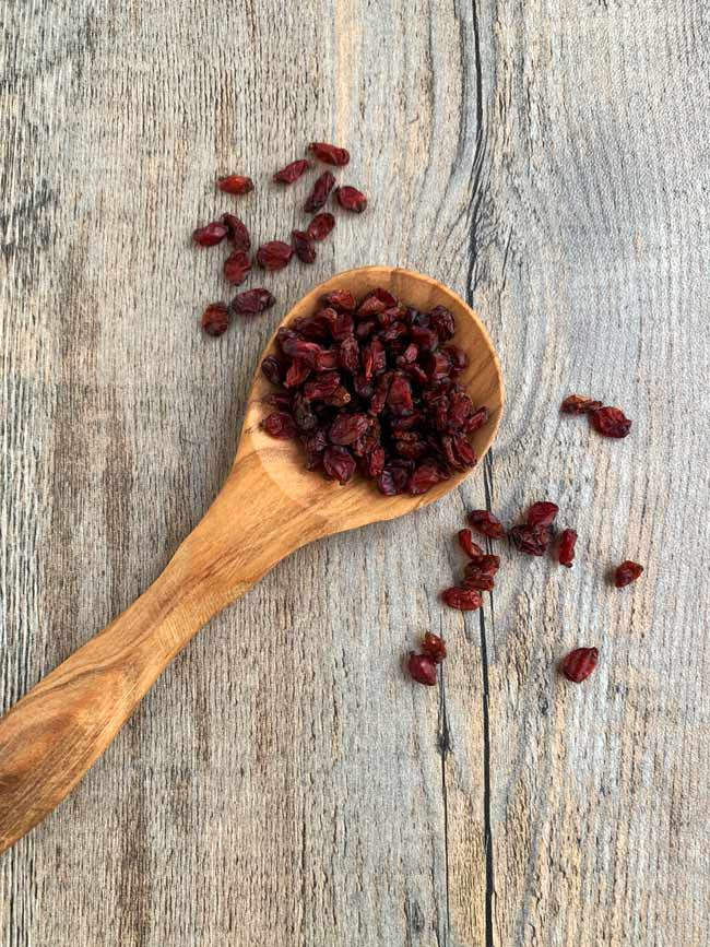 barberries on wooden spoon
