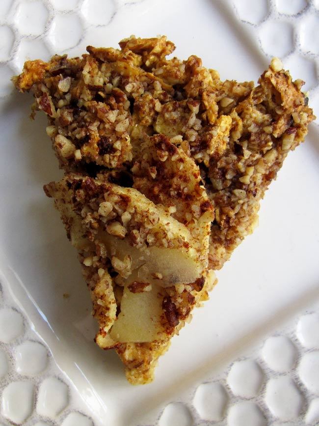 Matzo Farfel Kugel pie shaped slice on white plate looking straight down