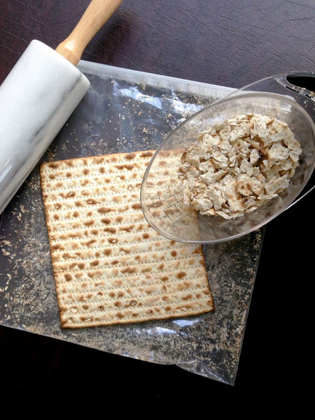Matzo farfel kugel photo showing rolling pin and matzo boards being made into matzo farfel