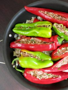 red and green stuffed Romano peppers in pan