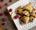 cranberry orange rugelach on white plate