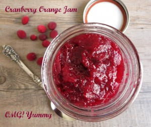 cranberry orange jam on a wood background with red words