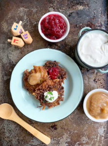 Potato Latkes with cranberry orange jam, apple sauce, sour cream, and dreidels
