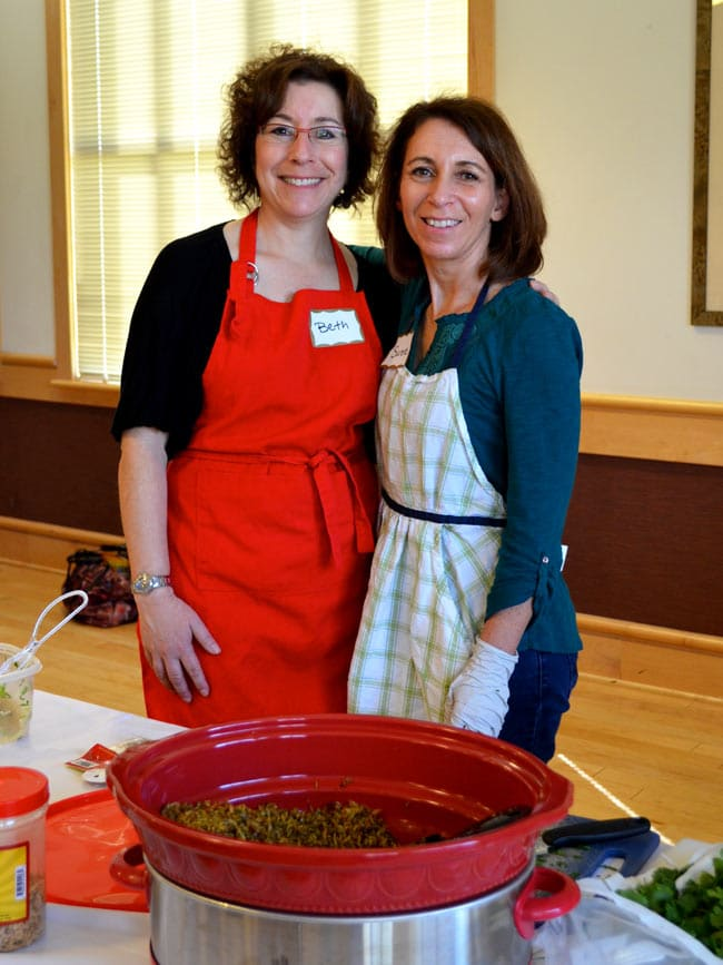 Beth and Sarene at cooking class in aprons