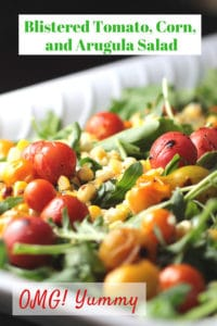 Tomato, Corn, and Arugula Salad on a white platter