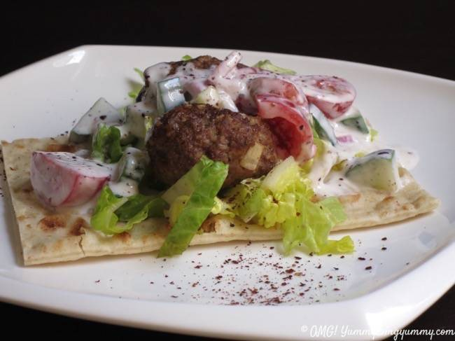 "From ""Yogurt Culture"" by Cheryl Sternman Rule, this lamb kefte features a lamb and bulgur meatball topped with a cucumber tomato sumac yogurt sauce. So many great flavors, your taste buds won't know what hit them!"