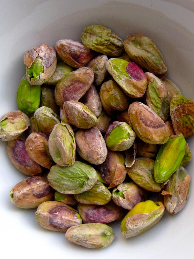 pistachios in white bowl