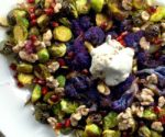 brussels sprouts and cauliflower on white plate with yogurt topping