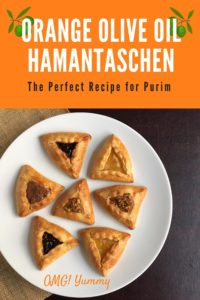 hamantaschen face down image of baked cookies on a white plate