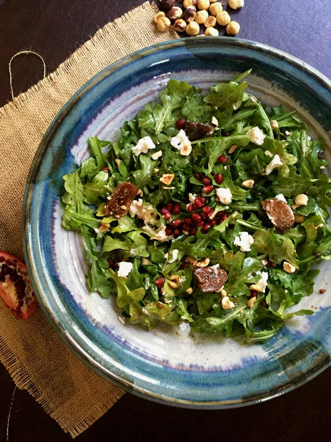 arugula and fig salad in blue bowl