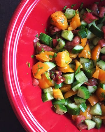 cucumber tomato salad in red bowl cropped for feature image size