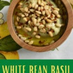 pinterest image showing a bowl of white bean hummus style dip with pine nuts