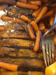 Instant Pot Brisket sliced and back in pot with carrots and potatoes