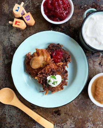 3 potato latkes with 3 toppings made with the best latke recipe