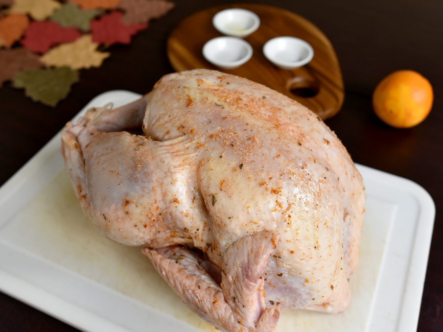 dry brined turkey on white board uncooked