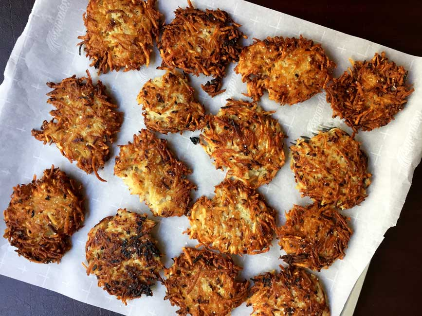 potato latkes on parchment showing salt