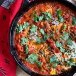 face down view of shakshuka in pan ready to eat