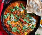 Shakshuka in cast iron with pita bread