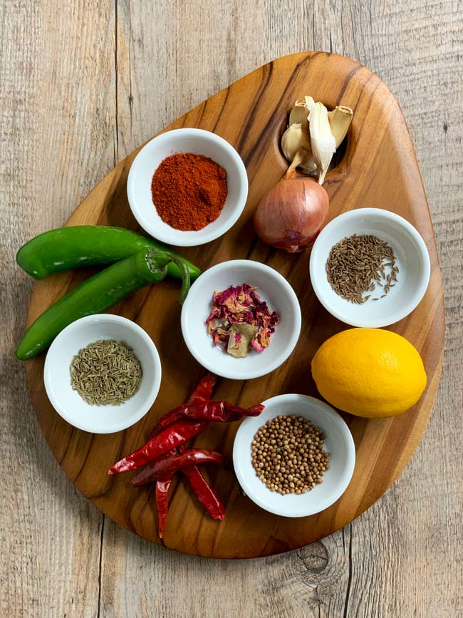 rose harissa ingredients in white bowls on wooden cutting board