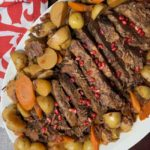 pomegranate molasses brisket plated with vegetables