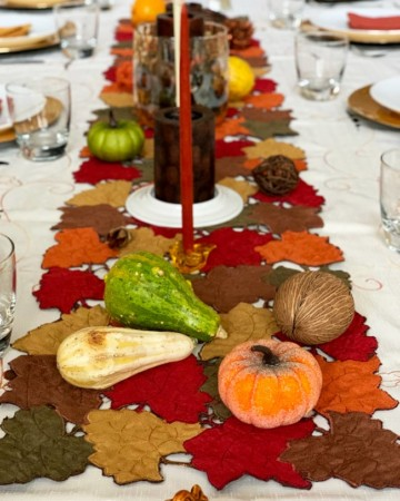thanksgiving table set with candles and gourds