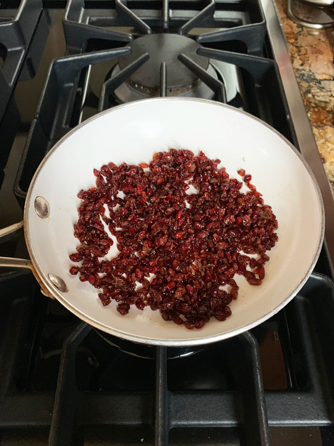 barberries sauteing in white fry pan