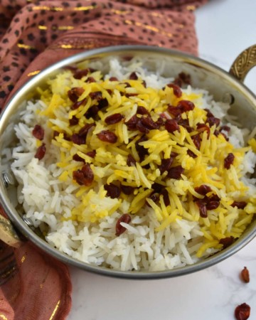 index image of beauty shot of saffron barberry rice with gold-flecked scarf