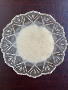 rinsed rice in clear bowl