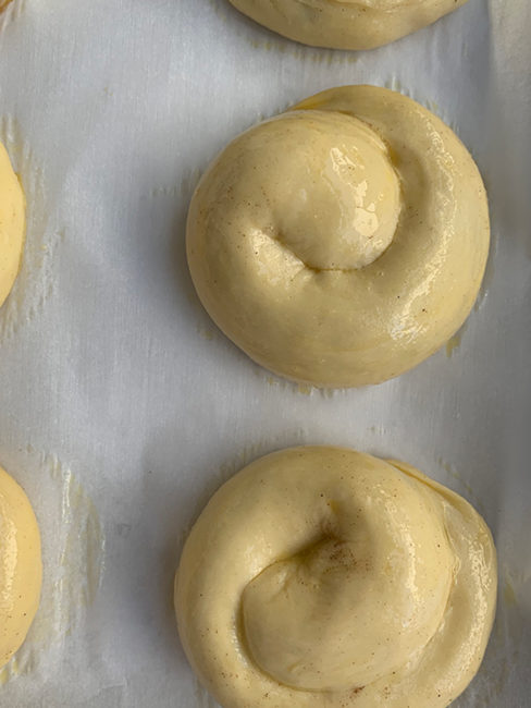 egg washed rolls on parchment