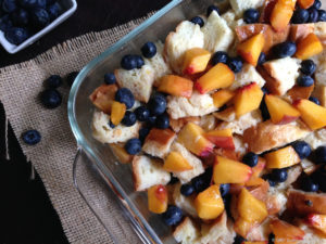 challah bread pudding with peaches and blueberries uncooked