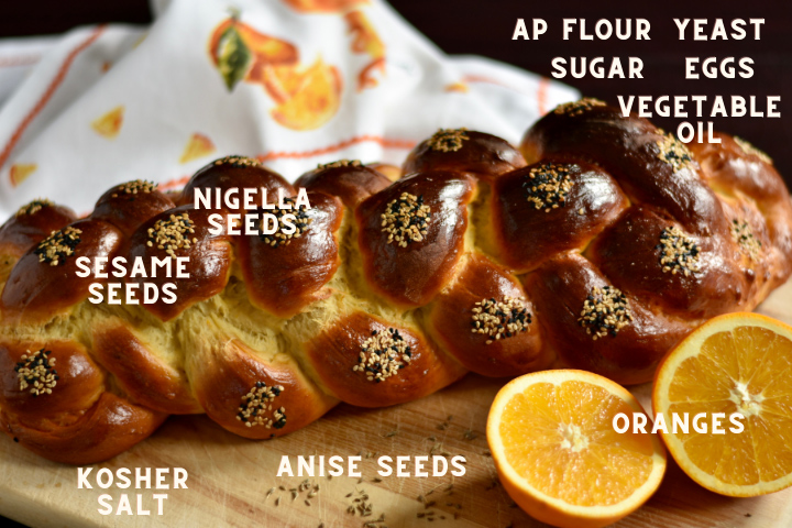 baked challah bread and a sliced orange with ingredients listed on the photo