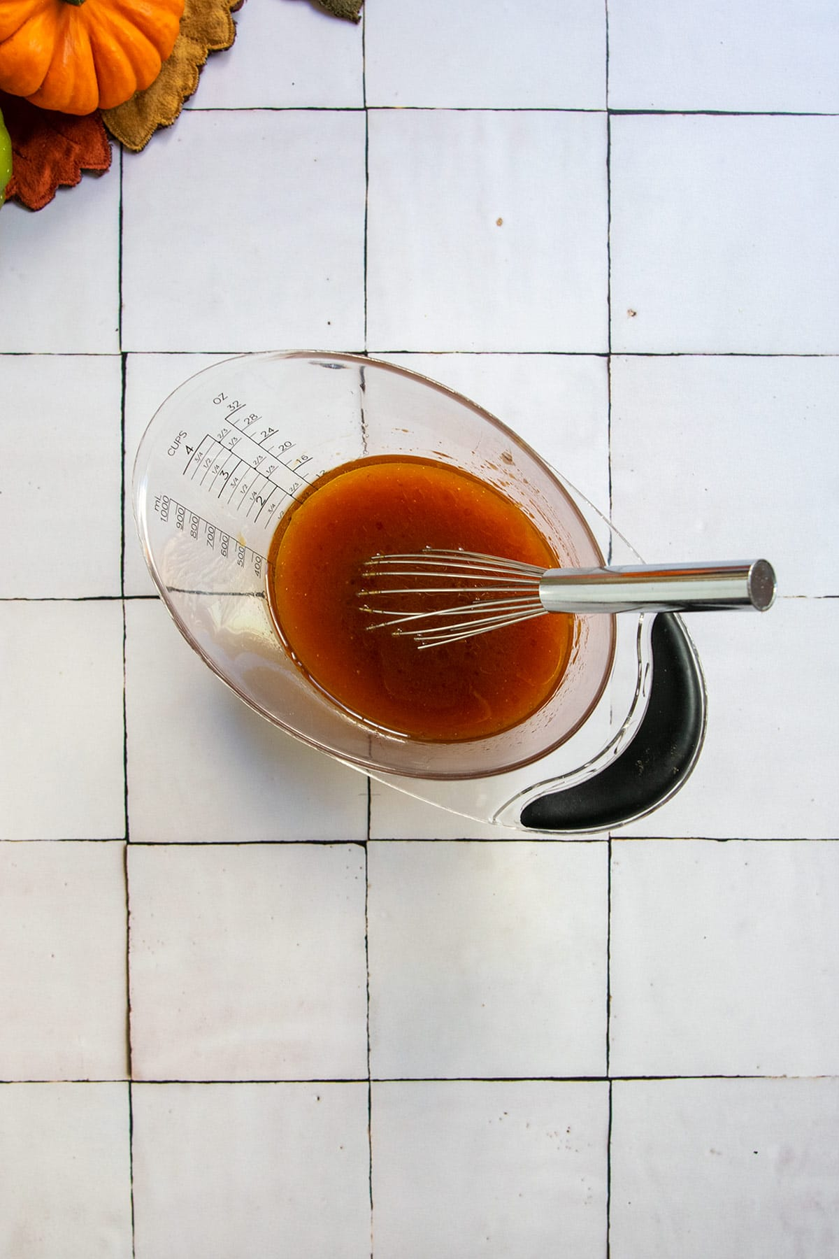 olive oil, maple syrup and honey in measuring cup