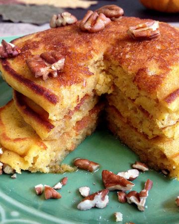 stack of pumpkin pancakes on green plate